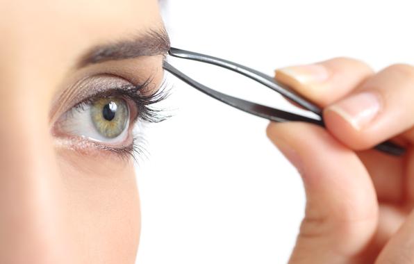 tweezers-eyebrows-eyes-woman.jpg